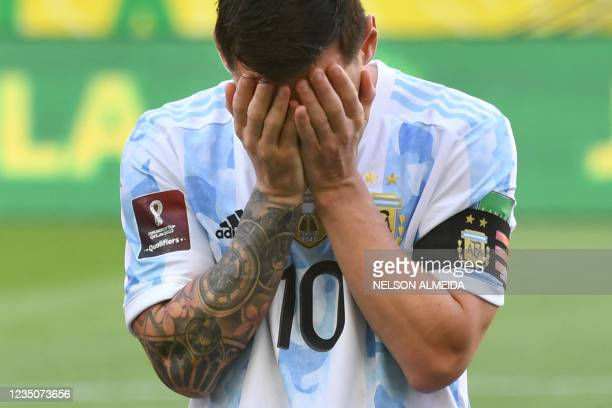 Argentina's Lionel Messi gestures before the South American qualification football match for the FIFA World Cup Qatar 2022 between Brazil and...