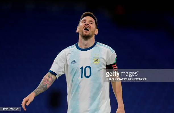 Argentina's Lionel Messi gestures during the closed-door 2022 FIFA World Cup South American qualifier football match against Paraguay at La Bombonera...