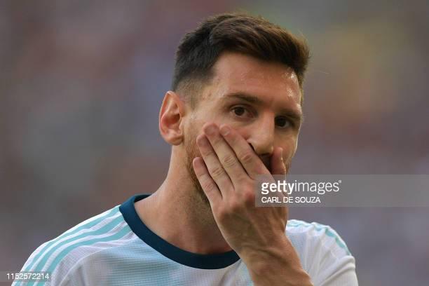 TOPSHOT Argentina's Lionel Messi gestures during the Copa America football tournament quarterfinal match against Venezuela at Maracana Stadium in Rio...