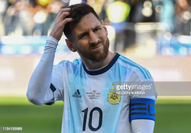 TOPSHOT Argentina's Lionel Messi gestures during the Copa America football tournament thirdplace match against Chile at the Corinthians Arena in Sao...