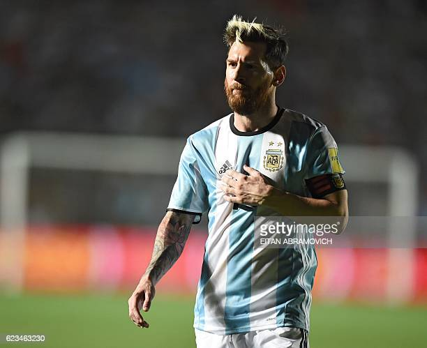 Argentina's Lionel Messi gestures during their 2018 FIFA World Cup qualifier football match against Colombia in San Juan Argentina on November 15...