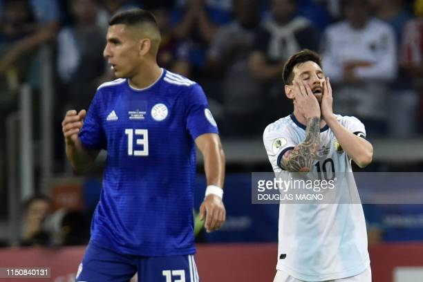 Argentina's Lionel Messi gestures near Paraguay's Junior Alonso after tying 1-1 in their Copa America football tournament group match at the Mineirao...