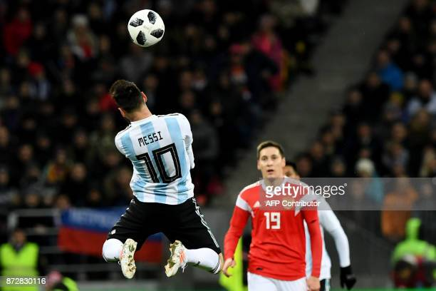 Argentina's Lionel Messi heads the ball during an international friendly football match between Russia and Argentina at the Luzhniki stadium in...