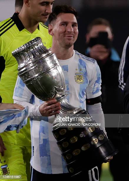 Argentina's Lionel Messi holds the Copa America trophy at the end of their South American qualification football match for the FIFA World Cup Qatar...