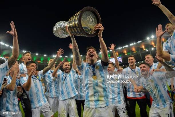 Argentina's Lionel Messi holds the trophy as he celebrates with teammates after winning the Conmebol 2021 Copa America football tournament final...