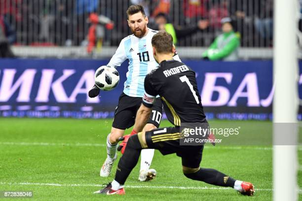 Argentina's Lionel Messi in action against Russia's goalkeeper Igor Akinfeev during an international friendly football match between Russia and...