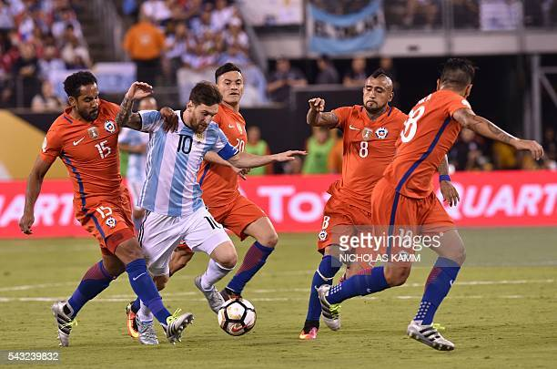 Argentina's Lionel Messi is marked by Chile's Jean Beausejour during the Copa America Centenario final in East Rutherford New Jersey United States on...
