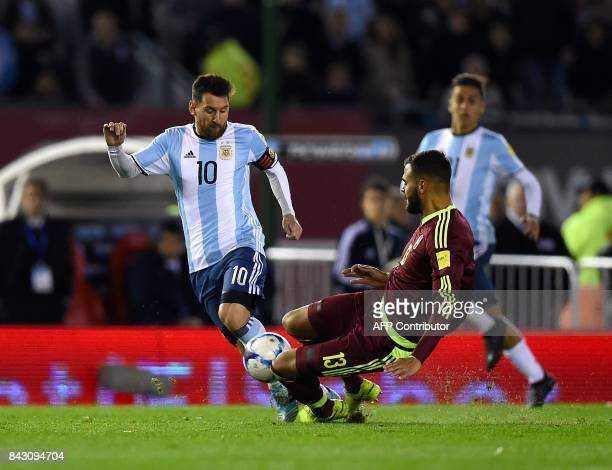 Argentina's Lionel Messi is marked by Venezuela's Jhon Chancellor during their 2018 World Cup qualifier football match in Buenos Aires on September 5...