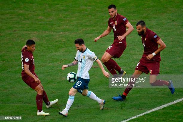 TOPSHOT Argentina's Lionel Messi is marked by Venezuela's Ronald Hernandez Luis Del Pino Mago and Jhon Chancellor during their Copa America football...