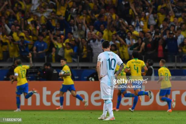 Argentina's Lionel Messi is pictured as Brazilian players celebrate the goal by teammate Gabriel Jesus during their Copa America football tournament...