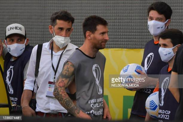 Argentina's Lionel Messi is seen after employees of the National Health Surveillance Agency entered to the field during the South American...