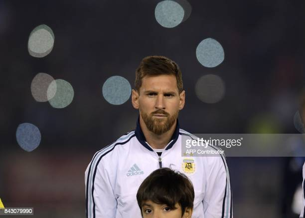 Argentina's Lionel Messi listens to the national anthem before the start of the 2018 World Cup qualifier football match against Venezuela in Buenos...
