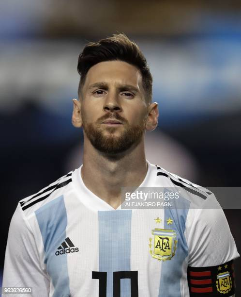 Argentina's Lionel Messi listens to the national anthems before the start of the international friendly football match against Haiti at Boca Juniors'...
