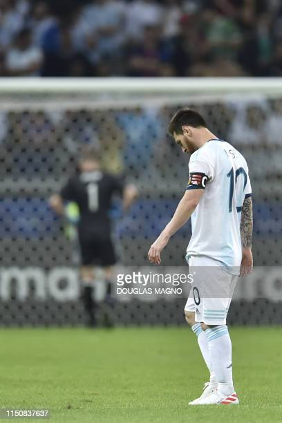 Argentina's Lionel Messi looks at the ground after Paraguay's Richard Sanchez scored a goal during their Copa America football tournament group match...