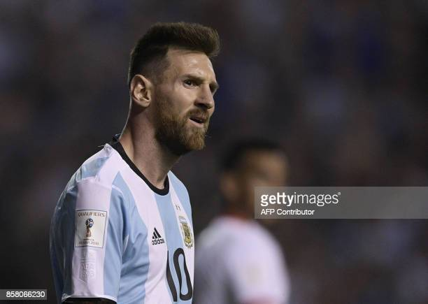 Argentina's Lionel Messi looks on during the 2018 World Cup qualifier football match against Peru in Buenos Aires on October 5 2017 / AFP PHOTO /...