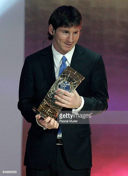 Argentina's Lionel Messi receives the 2009 FIFA World Player Trophy from UEFA President Michel Platini and FIFA President Sepp Blatter during the...