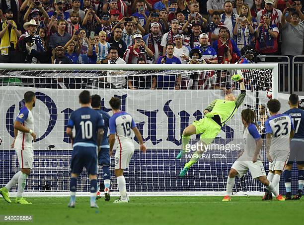 TOPSHOT Argentina's Lionel Messi scores a freekick past USA's goalkeeper Brad Guzan during their Copa America Centenario semifinal football match in...