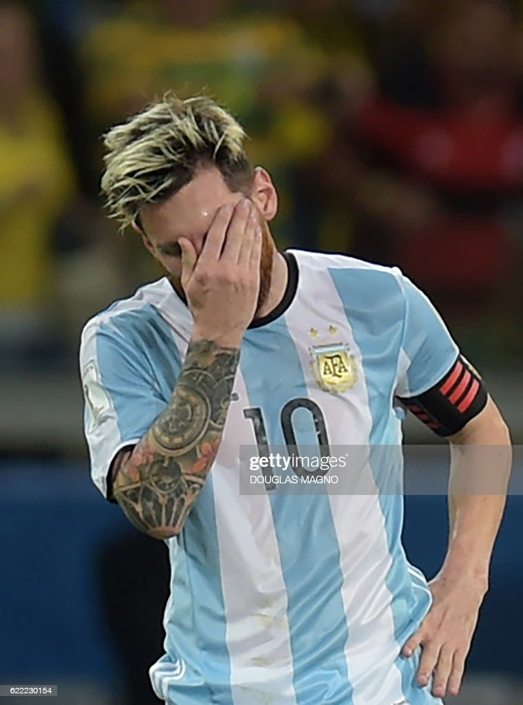 Argentina's Lionel Messi shows his dejection after Brazil's Neymar scored the team's second goal during their 2018 FIFA World Cup qualifier football match in Belo Horizonte, Brazil, on November 10, 2016. / AFP /