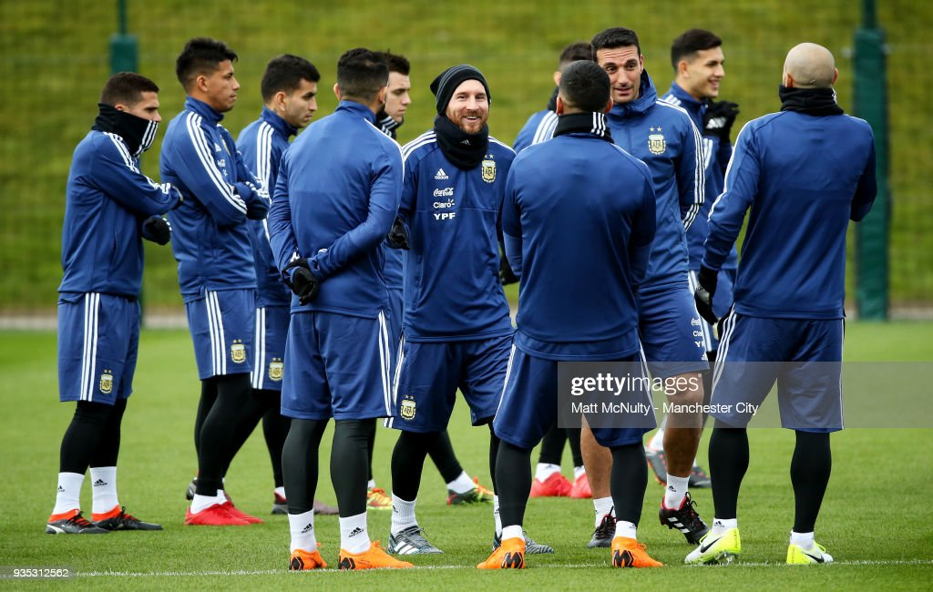 Argentina's Lionel Messi smiles with teammates during the training session at Manchester City Football Academy on March 20, 2018 in Manchester, England.