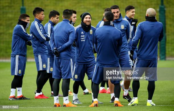 Argentina's Lionel Messi smiles with teammates during the training session at Manchester City Football Academy on March 20 2018 in Manchester England