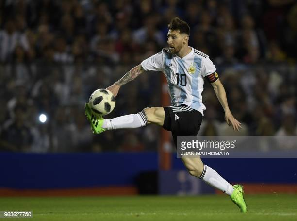 Argentina's Lionel Messi stretches for the ball during the international friendly football match against Haiti at Boca Juniors' stadium La Bombonera...