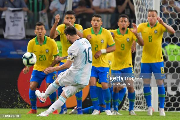 Argentina's Lionel Messi takes a free-kick against Brazil during their Copa America football tournament semi-final match at the Mineirao Stadium in...