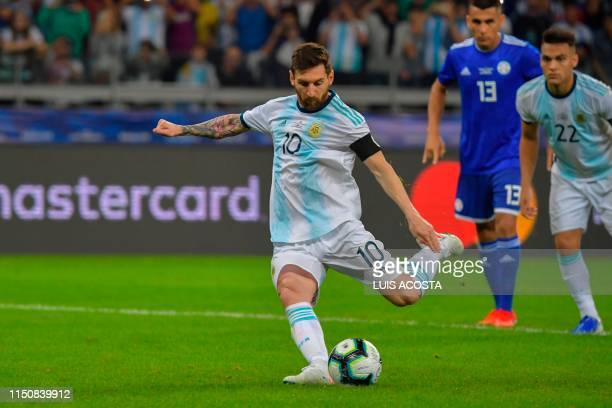 Argentina's Lionel Messi takes a penalty awarded by the VAR after a hand in the area to score against Paraguay during their Copa America football...
