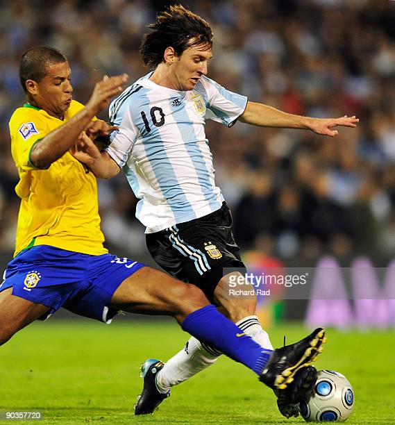Argentina's Lionel Messi vies for the ball with Felipe Melo of Brazil during their 2010 FIFA World Cup qualifier at the Gigante de Arroyito stadium...