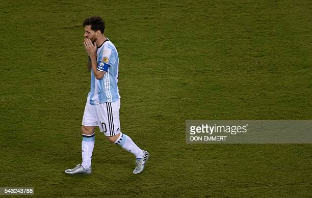 TOPSHOT Argentina's Lionel Messi walks after missing his shot during the penalty shootout against Chile during the Copa America Centenario final in...