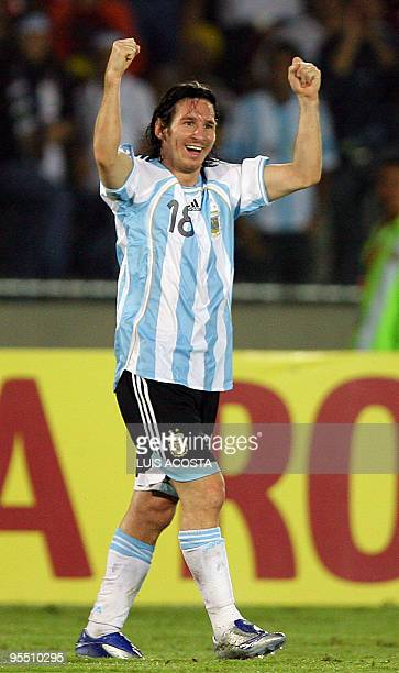 Argentina's Lionel Messi walks calmly and rising both fists to celebrate his goal scored against Mexico during their Copa America Venezuela2007...