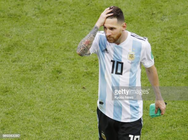 Argentina's Lionel Messi walks off the pitch looking dejected after his side lost 43 to France in a World Cup roundof16 match in Kazan Russia on June...