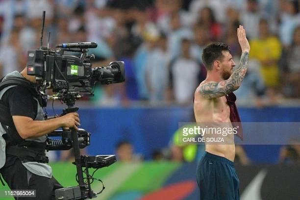 Argentina's Lionel Messi waves after the Copa America football tournament quarterfinal match against Venezuela at Maracana Stadium in Rio de Janeiro...