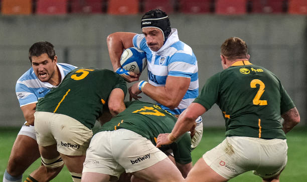 Argentinas lock Tomas Lavanini (C) is tackled by South Africa's prop Steven Kitshoff (down) during the Rugby Championship international rugby union Test match between South Africa and Argentina at The Nelson Mandela Bay Stadium in Port Elizabeth on August 21, 2021. (Photo by Michael Sheehan / AFP) (Photo by MICHAEL SHEEHAN/AFP via Getty Images)