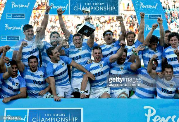 Argentina's Los Pumas celebrate after defeating South Africa's Springboks in a Rugby Championship 2018 test match at Malvinas Argentinas stadium in...