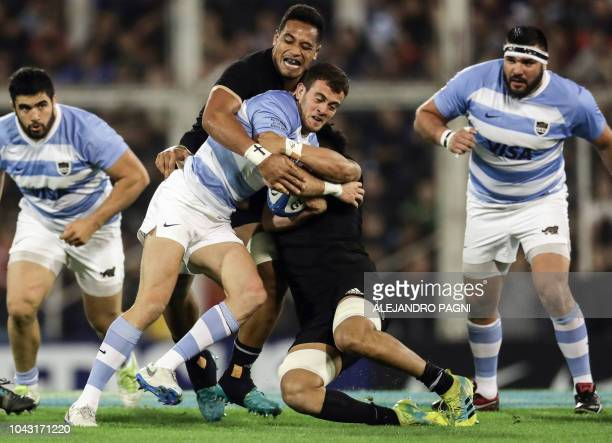 Argentina's Los Pumas fullback Emiliano Boffelli vies for the ball with New Zealand's All Blacks Ardie Savea and New flanker Shannon Frizell during...