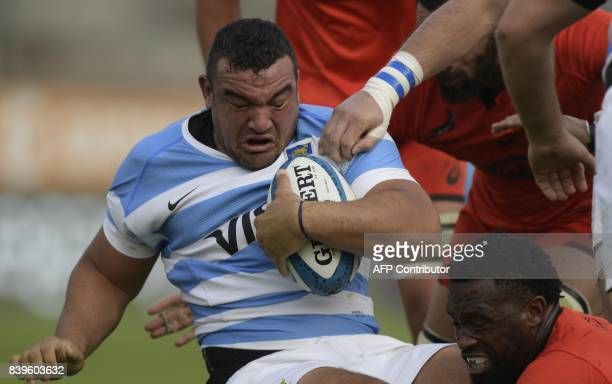 Argentina's Los Pumas hooker Agustin Creevy is tackled by South Africa's flanker Siya Kolisi during their Rugby Championship match at Padre Ernesto...