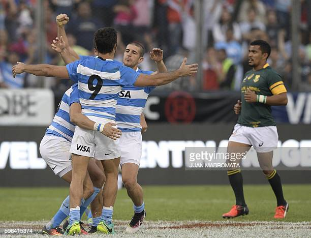 Argentina's Los Pumas rugby players celebrate after defeating South Africa by 2624 in their Rugby Championship match at Padre Ernesto Martearena...