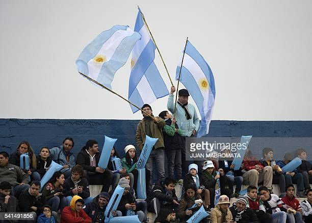 Argentina's Los Pumas supporters wave the Argentine flag before the start of the Rugby Union test match against France at Jose Fierro stadium in...