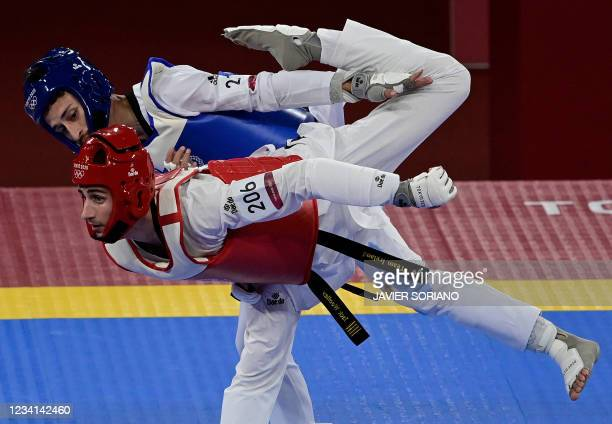 Argentina's Lucas Lautaro Guzman and Ireland's Jack Woolley compete in the taekwondo men's -58kg elimination round bout during the Tokyo 2020 Olympic...