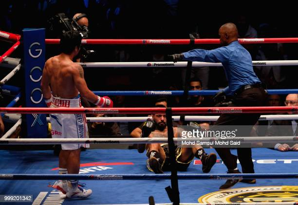 Argentina's Lucas Matthysse fall during fight with Philippine's Manny Pacquiao for their World welterweight boxing championship title bout in Kuala...