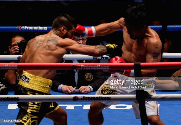 Argentina's Lucas Matthysse fight with Philippine's Manny Pacquiao during their World welterweight boxing championship title bout in Kuala Lumpur...