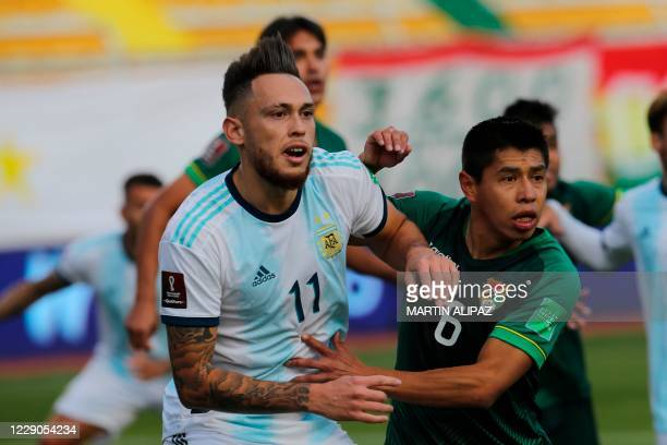 Argentina's Lucas Ocampos and Bolivia's Diego Wayar vie during their 2022 FIFA World Cup South American qualifier football match at the Hernando...