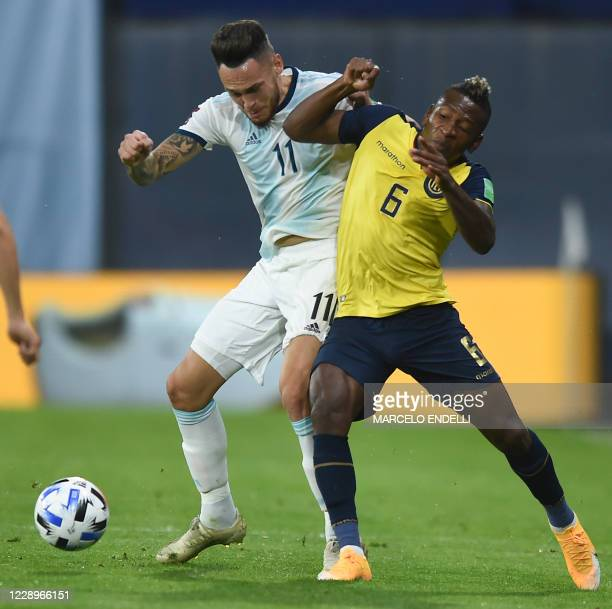 Argentina's Lucas Ocampos and Ecuador's Pervis Estupinan vie for the ball during their 2022 FIFA World Cup South American qualifier football match at...