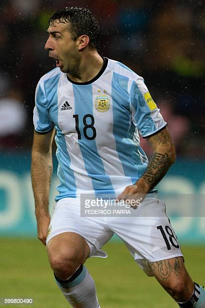 Argentina's Lucas Pratto celebrates after scoring a goal against Venezuela during their Russia 2018 World Cup football qualifier match in Merida...
