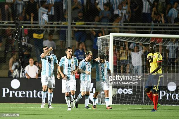 TOPSHOT Argentina's Lucas Pratto celebrates after scoring against Colombia during their 2018 FIFA World Cup qualifier football match in San Juan...