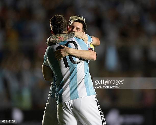 TOPSHOT Argentina's Lucas Pratto celebrates with teammate Lionel Messi after scoring against Colombia during their 2018 FIFA World Cup qualifier...