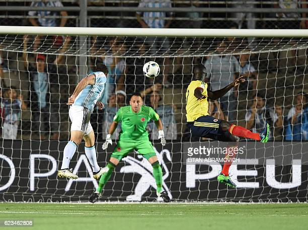 TOPSHOT Argentina's Lucas Pratto scores against Colombia during their 2018 FIFA World Cup qualifier football match in San Juan Argentina on November...