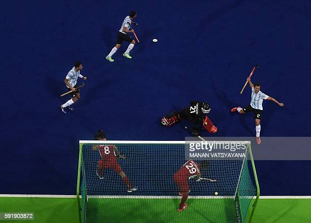 TOPSHOT Argentina's Lucas Vila celebrates a goal during the men's Gold medal field hockey Belgium vs Argentina match of the Rio 2016 Olympics Games...