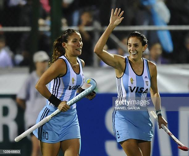 Argentina's Luciana Aymar celebrates next to teammate Soledad Garcia after she scored a goal against Germany during the field hockey semifinal match...
