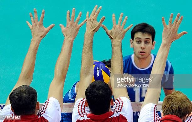 Argentina's Luciano de Cecco spikes the ball against Poland during their Volleyball World League bronze medal match in Gdansk on July 10 2011 AFP...